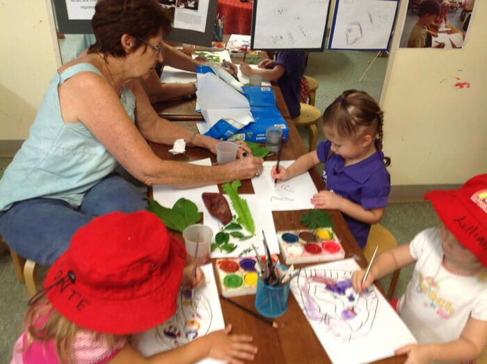kids working with an artist at Rainvow Valley Centre